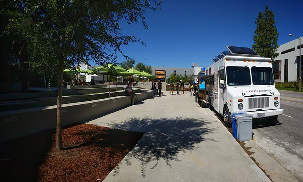 Food trucks on the same street as my office...never thought I'd see this. There are places to sit and actual tables with umbrellas here. I wonder how long it has been like this...I don't normally come this far down our street.