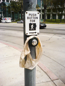 Which is safer:  Crossing Cloverfield without a walk signal or pushing this button?