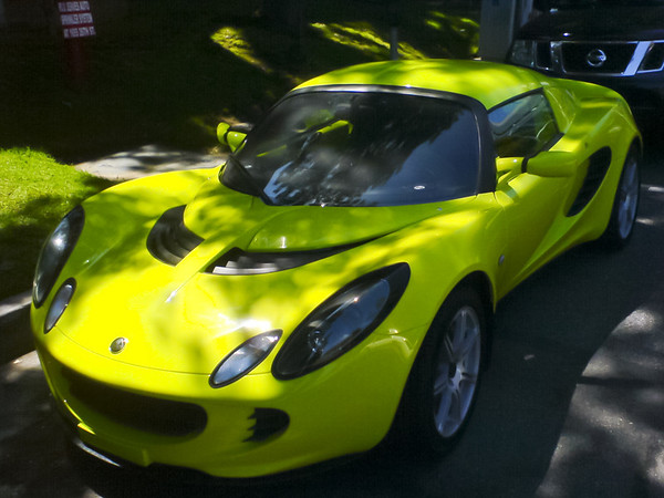 A lime green Lotus Elise is parked behind Border Grill's truck