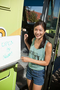 Misa emerges from the truck to tell the growing line that Nom Nom will open in five minutes