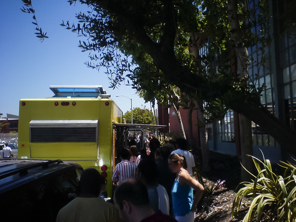 I usually try to hit the Nom Nom Truck BEFORE noon, but today their Facebook update indicated they wouldn't start serving until 12:15pm...and now I must wait in a line of people eager to get their Noms