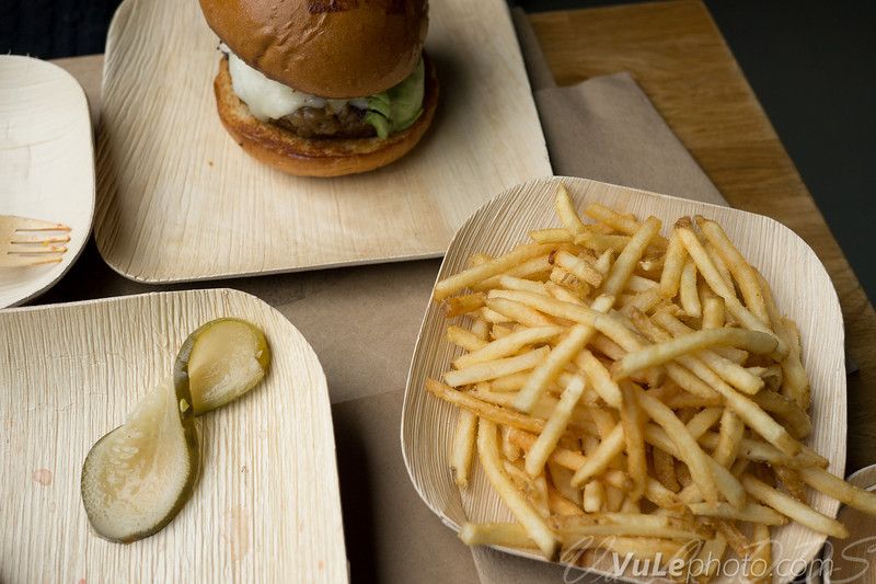 Burger, shoesring fries, and a pickle