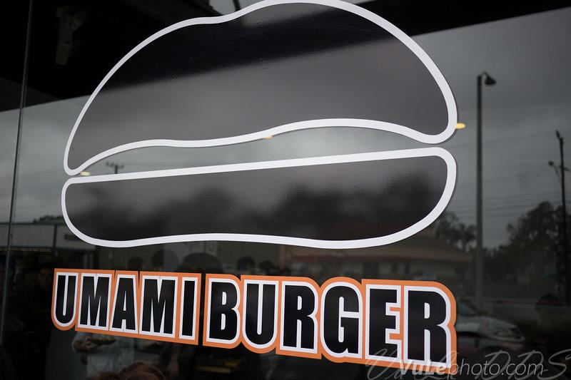 Umami Burger's logo evokes a burger, a shitake mushroom, as well as a pair of lips