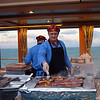 Barbecuing steaks on the deck of Holland America's Volendam before dinner.