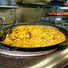 A huge dish of paella on a fast food counter. (Valencia, Spain)