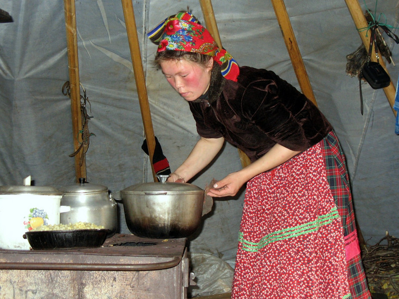 Cooking on the tundra above the Arctic Circle. A woman's work is never done. (Nenets Autonomous District, Russia)