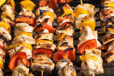 Barbecuing chicken skewers kebab