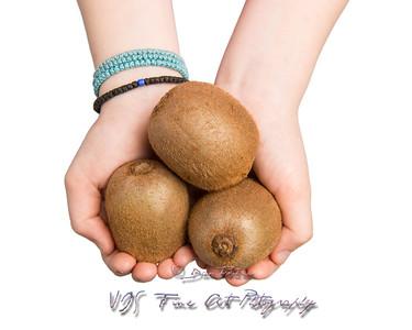 Hands Offering Kiwi Fruit