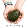 Hands Offering an Avocado