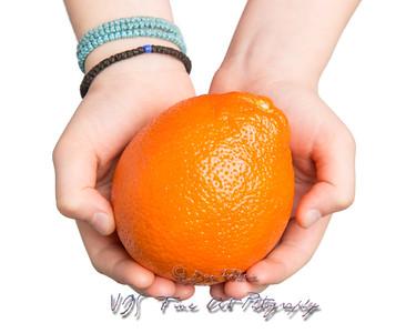 Hands Offering an Orange