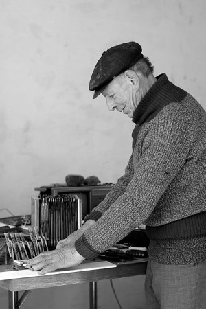 Preparing for a second life  Old man repairing his accordion  Everything I know I learned myself. Anybody could master it if he observes the process carefully.  Nothing is complicated.  People ask me to repair their instruments.  I am happy to help them. There is one drum that I have finished recently and it is waiting for his master now. Currently I am busy with the contrabass one friend left me. I have a dream to make a small accordion for myself to play with in my band.