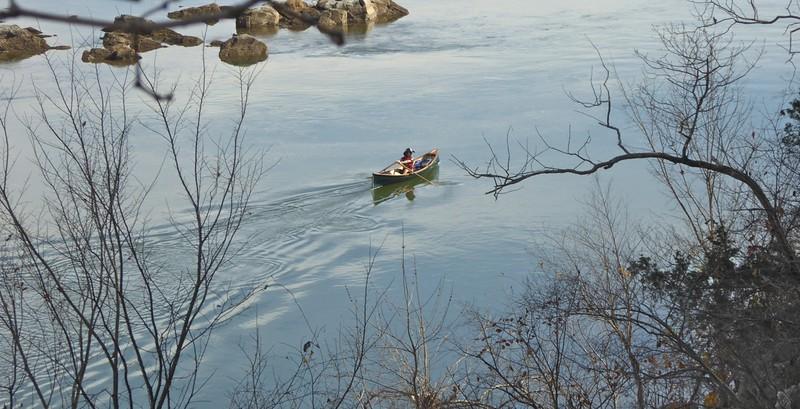 W - Boatman rowing canoe down Potomac