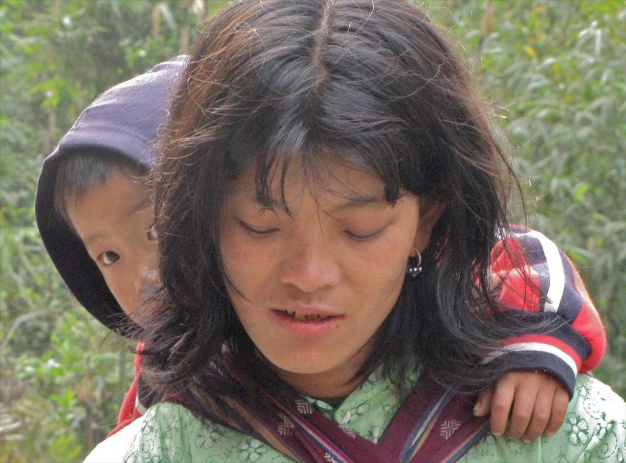 W-Bhutan mother avoids eye contact but not son