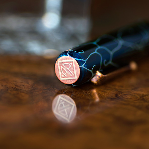 """AP"" logo on the cap of The Charismatic Sea Turtle fountain pen"