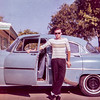 Me and my first car, a '53 Chevy. Taken in late 1961 or early '62.