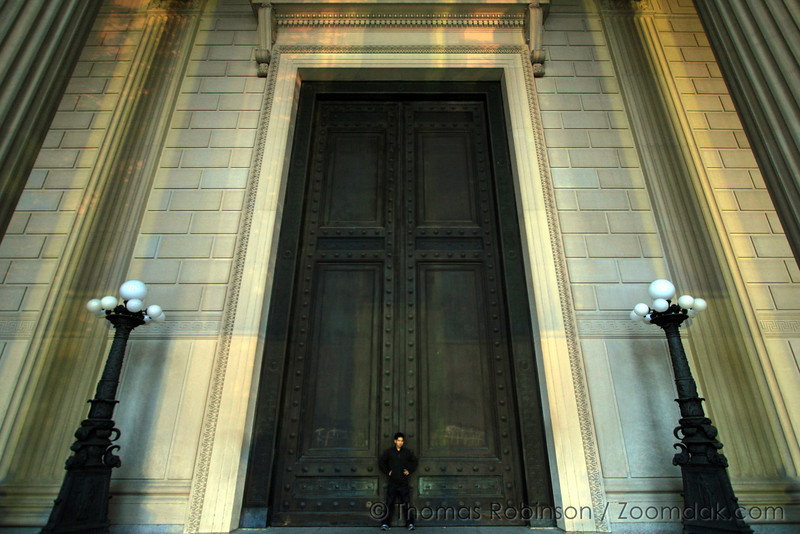 DC Doors – 25 October 2007 – During a media conference trip to Washington DC, Tim Takechi stands in front of the doors to the National Archives Building.
