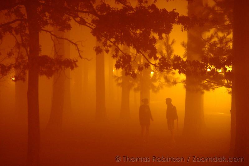 Conversation in the Fog – 18 November 2005 – The lights of the loop illuminate the loop as Karissa Thompsen and Bryan Jones talk together.