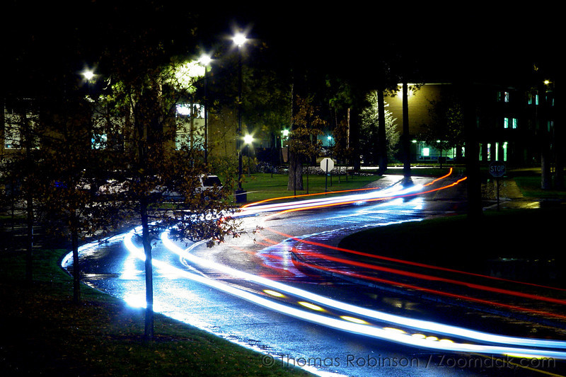 Lights – 4 November 2005 – During a rainy evening, a timed exposure shows the light streaks of cars on Whitworth drive near BJ.
