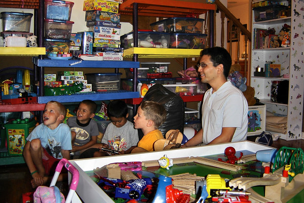 While JJ plays Eric's PSP, Eric attempts to impress a group of kids with his game-playing skills... (photo by Valerie)