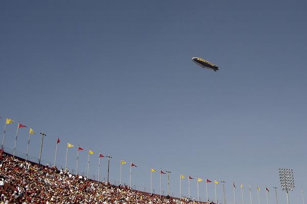 The Good Year Blimp flies overhead