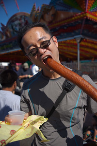 Despite sharing the Pink's dog with me, Pete insists on trying a Texas-sized corn dog!