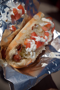 "Pete and I share a Martha Stewart Dog (10"" Stretch Dog, relish, onions, bacon, chopped tomatoes, sauerkraut & sour cream)"