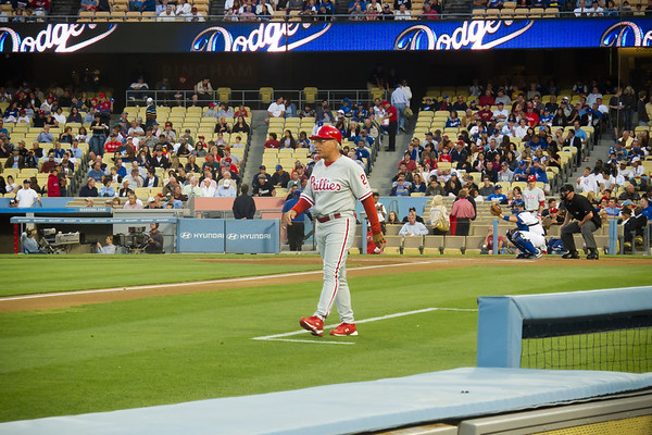 Phillies' third base coach Sam Perlozzo moves into position