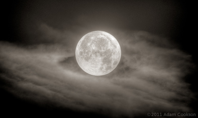 This is the 'super perigee moon' of 2011-03-19. When the moon's closest approach to Earth coincides with a full moon, it looks brighter and bigger. This one was 14% bigger than normal and the largest in 18 years. This is an HDR composite of four images taken of the moon at approximately 5am mountain daylight time in Broomfield, Colorado.