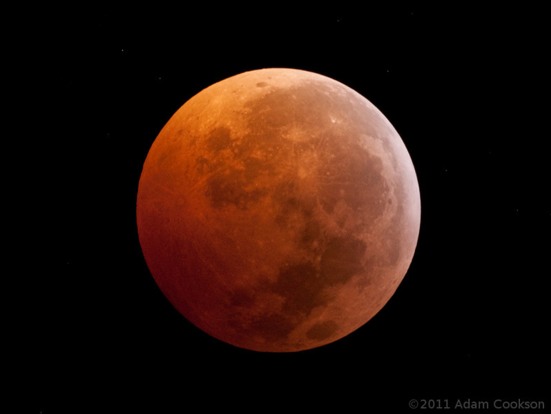 This was taken during the 2010 winter solstice lunar eclipse, with a borrowed 1000mm Nikkor reflex lens. (Thanks Ryan!)