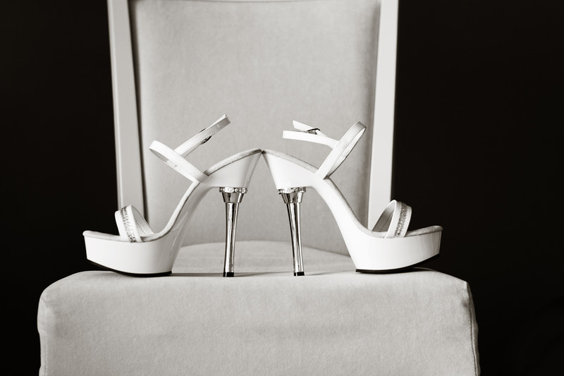 One of my favorite photographs, a bride's shoes.  Check out those heels!