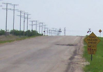 The long telescopic picture of hot asphault in Saskatchewan. I love the effect of the heat rising off the pavement.