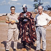 Nigeria, Oyo (1959) - Me (left), the Alaphine of Oyo (centre, holding my camera) and Charlie Hatton (right) outside the Alaphine's palace.