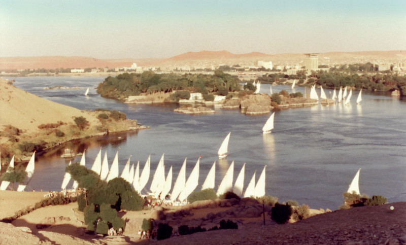 Egypt, Aswan (1981) - Fleets of feluccas crossing the River Nile just below the first cataract.