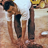 Iran (1959) - Our field cook, Mahmoud Khorsandi, killing a chicken.