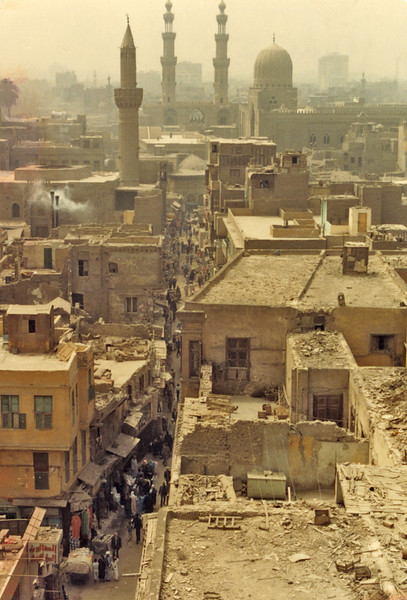 Egypt, Islamic Cairo (1982) - View south along Sharia Mu'izz-el-din-Allah from minaret of Qalaun's mosque. Twin minarets in the distance rise above the towers of the Bab Zuweila.