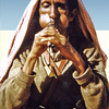South Arabia (1962) -The original bagpiper. He uses his cheeks as the bags. The pipe on his left is the 'drone'.