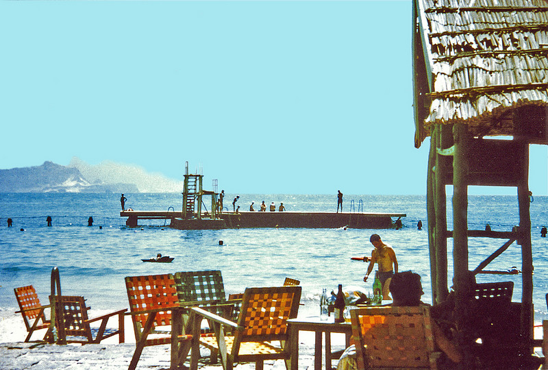 South Arabia, Aden (1960s) - Gold Mohur Bathing Club. Note diving platform (at high tide) and shark nets. Mountain in distance is Little Aden.