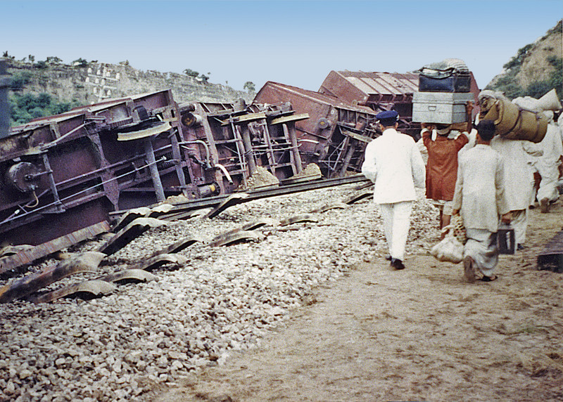 Pakistan, Between the Indian border and Lahore (1958) - Train wreck. Pakistani nationals are in the process of moving all their worldly goods from our first train (the one from Amritsar) to our second train (the one that reversed all the way to Lahore.