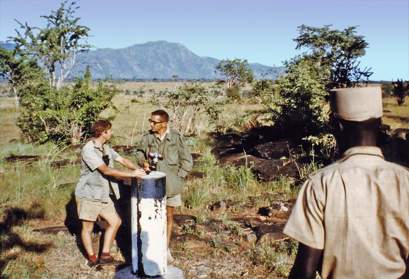 Uganda/Sudanese border, (1965) - Roger and I and a Sudanese border guard at the border (the concrete pillar).