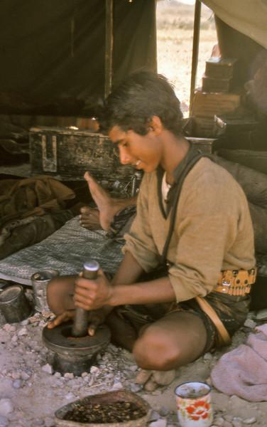 South Arabia:- Beit Zabina'at boy grinding coffee, Habarut.
