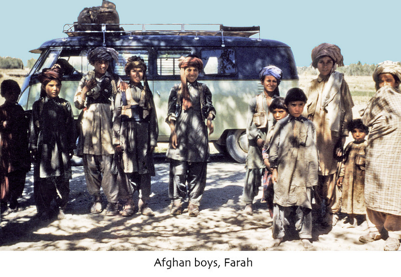 Afghanistan (1958) - Afghan boys who just seemed to materialise whenever we stopped to have a pee. Brown's VW campervan in rear.