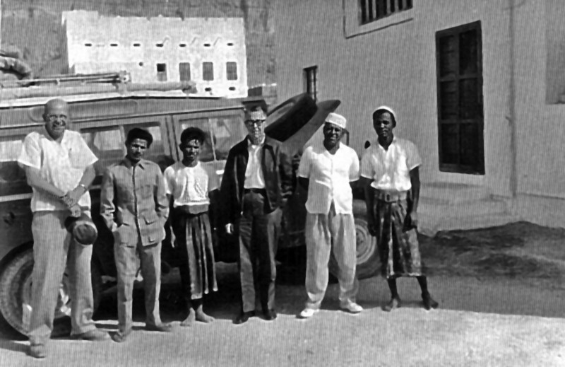 South Arabia (1964) - Part of our crew outside staff house in Seiyuun. Les Birbeck on left, Charlie Roberts in dark jacket.