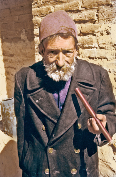 Iran, 1960) - Elderly man with pipe.
