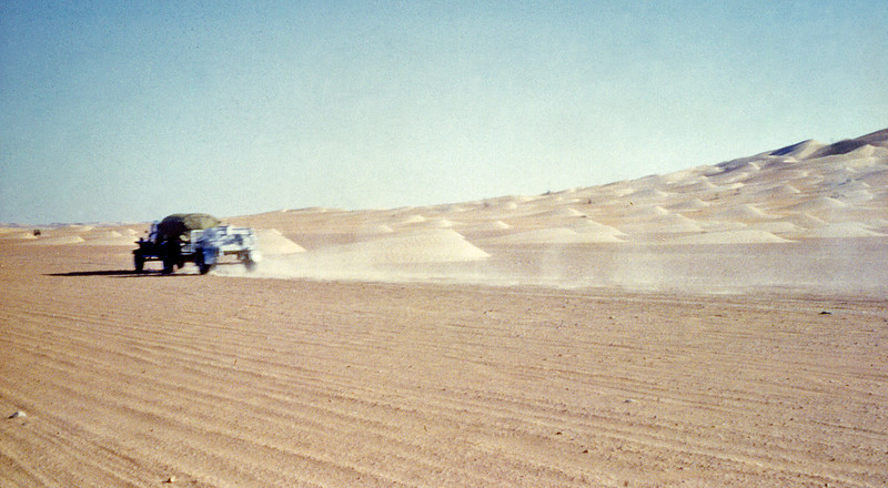 South Arabia (1964) - Doing the ton in the Northern Desert. Dunes of the Rub-al-Khali on the right.