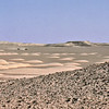 South Arabia (1964) - Looking north from the north edge of the Northern Jol. In middle distance is the Northern Desert. Southernmost dunes of the Rub-al-Khali rise against the horizon.