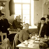 Iran, Nain (1959) - Bill Weaver (seated left) and Feiridoon Saleh (seated right) in the teahouse at Nain. Amir Abbas, the innkeeper, is serving lunch.