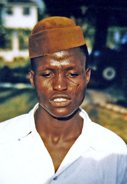 Nigeria (1959) - Ali, our bearer. Note tribal scars on his cheeks.