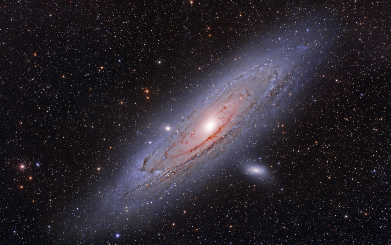 M31 The Andromeda Galaxy.  At 2.5 million light years from us, this is the closest spiral galaxy to our own.  It appears as wide as 6 full moons in the sky, so it is quite large.  The center of M31 is visible with the naked eye under good seeing conditions.   This was shot from Vanderpool, TX on November 28, 2011 with a new moon. The temperatures were in the mid 30's. This was shot with the Hap Griffin Modified Canon 5D markii and Takahashi FSQ106edxii at F5 on the AP1200. 10X15min at 400iso