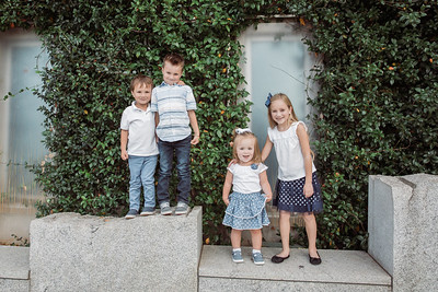 Garzon Siblings.  One way to get kids to smile and pose?  Let them climb and show you how tall they are!