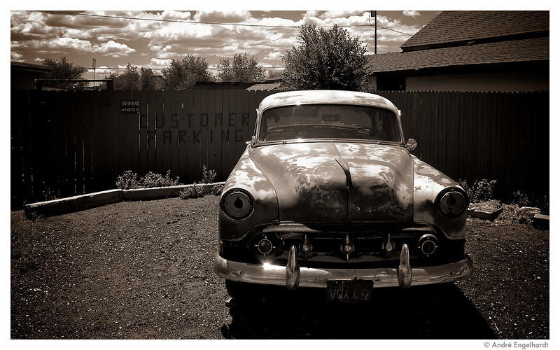 Old abandoned car in the sad town of Seligman along route 66.